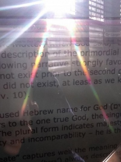 Sunlight through prism glass on biblical translation notes